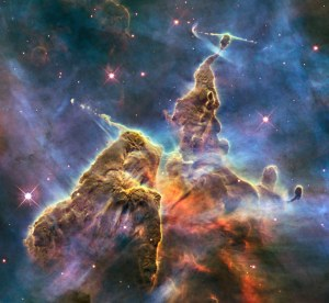 BIRTHING PAINS Jets of gas from newborn stars erupt from Mystic Mountain, a stellar nursery 7,500 light-years away in the Carina Nebula.